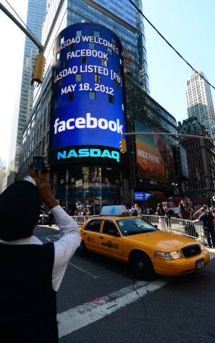 A sign announcing Facebook IPO is flashe