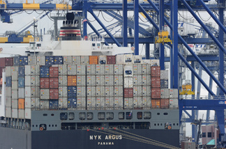 File photo: A container ship being unloaded is visible during the launch voyage of the Aquarium of the Pacific's new 'Urban Ocean' cruise, May 27, 2010 in San Pedro Bay off the coast of Los Angeles and Long Beach.