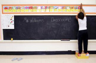 Ckaris Williams, a teacher and Hurricane Katrina evacuee, prepares her classroom at Douglass Elementary School in Houston September 7, 2005.