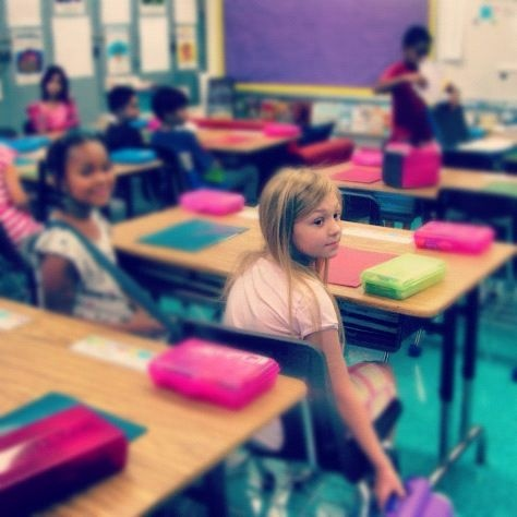 Tess Oswalt sits down for her first day of fourth grade at Calahan Elementary School in Northridge, Calif.