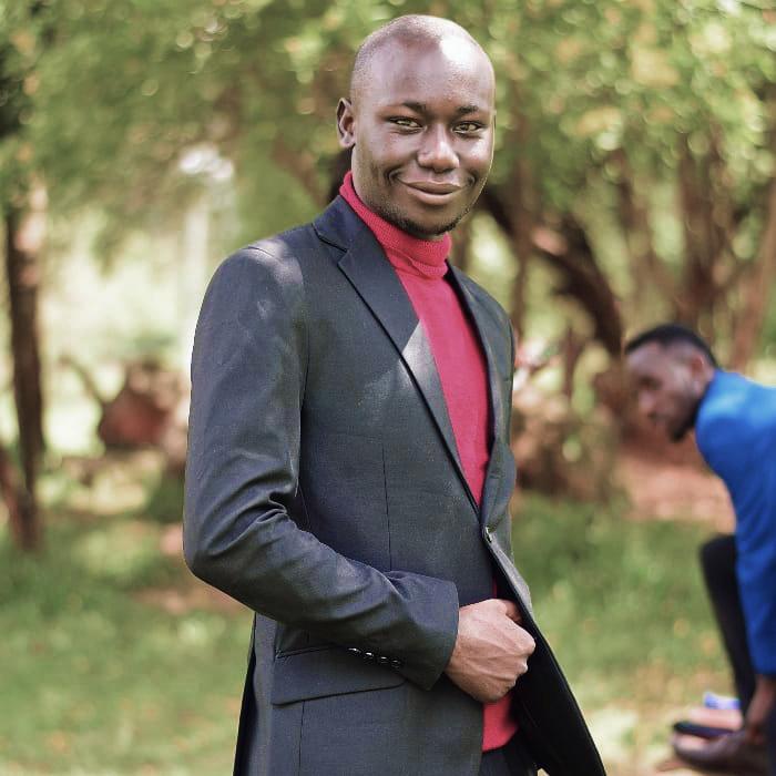 Samuel Mang'era at Kenyatta University's Arboretum in Nairobi. One of his messages to the coronavirus: