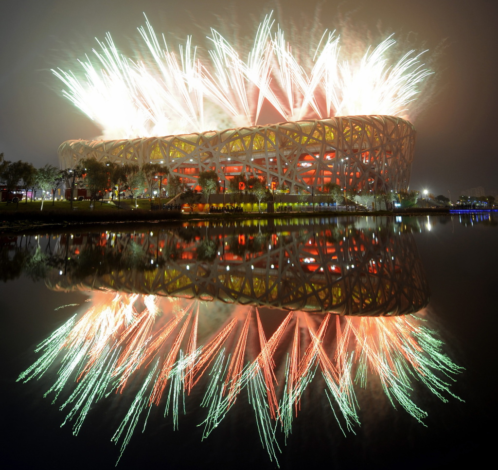 Fireworks explode next to the National Stadium, also known as the