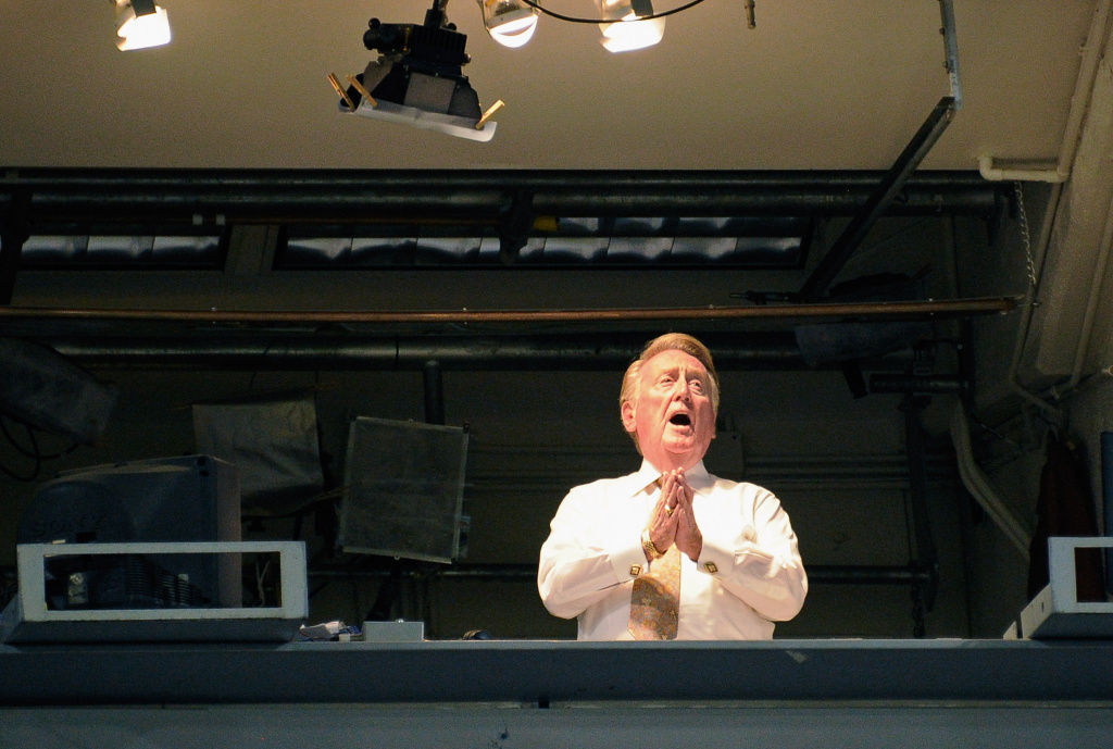 File: Vin Scully, the play-by-play voice of the Los Angeles Dodgers, sings