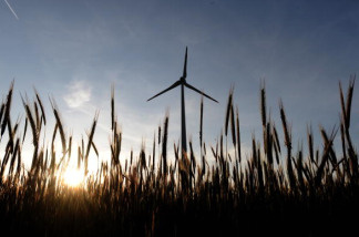 A wind turbine rises above field near the Austrian-Slovakian border during late afternoon on May 20, 2009.