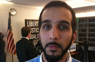 Ali Malik, at a news conference, is one of three plaintiffs named in a lawsuit against the FBI.