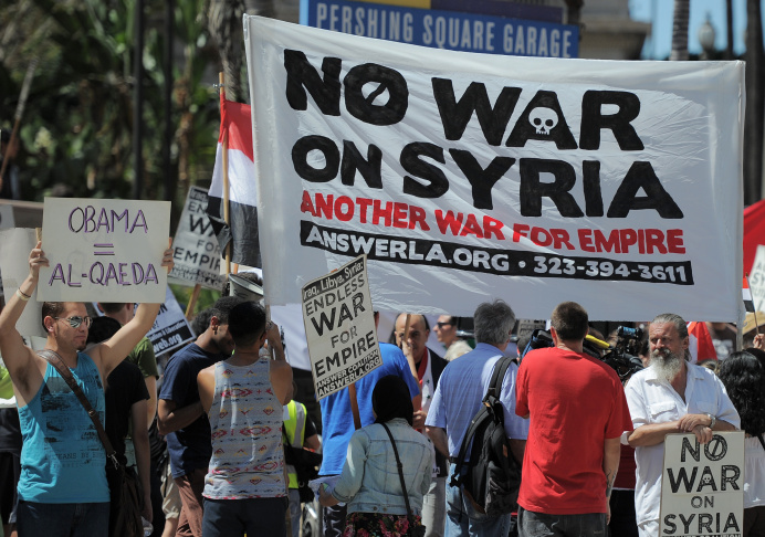 People demonstrate against a US-led strike on Syria in downtown Los Angeles on August 31, 2013.