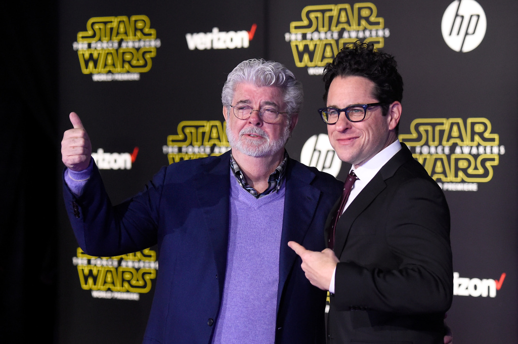 HOLLYWOOD, CA - DECEMBER 14:  Filmmaker George Lucas (L) and writer-director J.J. Abrams attend the Premiere of Walt Disney Pictures and Lucasfilm's