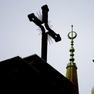 The cross of the the Maronite cathedral of Saint Georges is seen side by side along with the minaret of Moahmmed al-Amin Mosque in downtown Beirut on January 4, 2010.