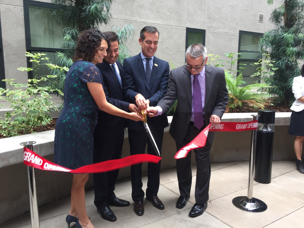 Mayor Eric Garcetti cuts the ribbon at the grand opening of the New Pershing Apartments in Downtown Los Angeles, a subsidized housing development for formerly homeless veterans on July 30, 2015.