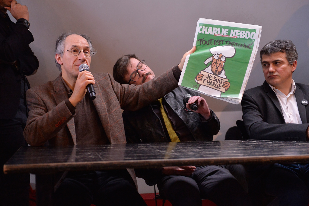 Charlie Hebdo editor in chief,  Gerard Briard (L) Charlie Hebdo cartoonist, Renald Luzier (C) aka Luz and Patrick Pelloux (R), Charlie Hebdo journalist,  during the Charlie Hebdo press conference held at the Liberation offices in Paris on January 13, 2015 in Paris, France.