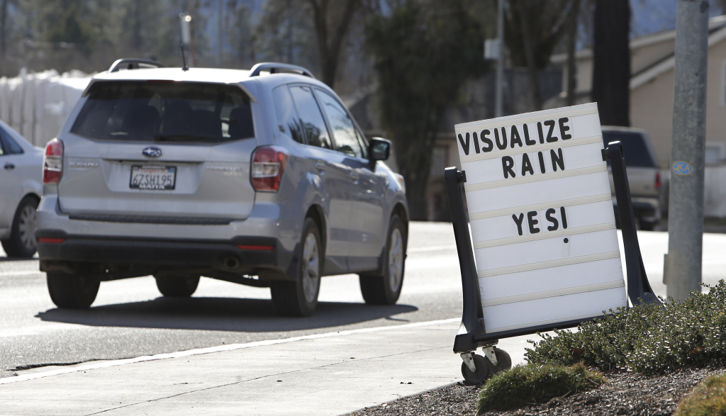 FILE: In this photo taken Tuesday, Feb. 4, 2014,  a sign outside a market in Willits, Calif., reminds passerby's about about the short water supply facing area residents.