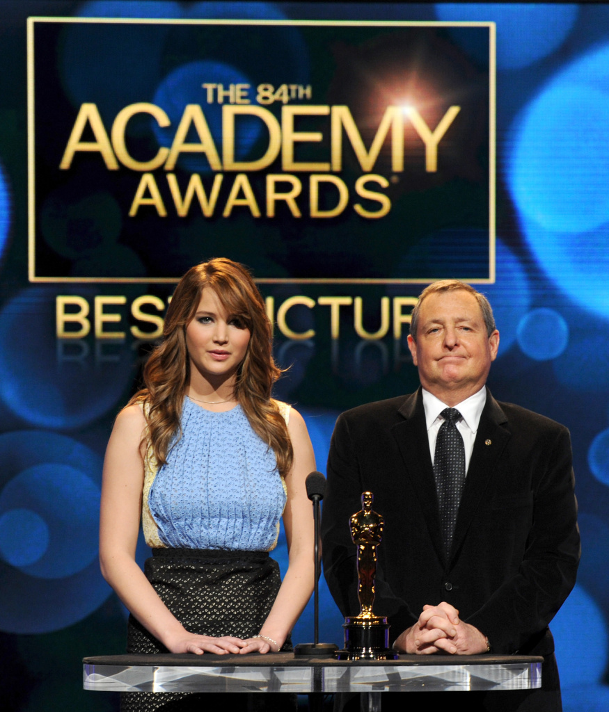 Actress Jennifer Lawrence (L) and Academy of Motion Picture Arts and Sciences President Tom Sherak speak onstage during the 84th Academy Awards announcement held at the Academy of Motion Picture Arts and Sciences Samuel Goldwyn Theater on January 24, 2012 in Los Angeles.