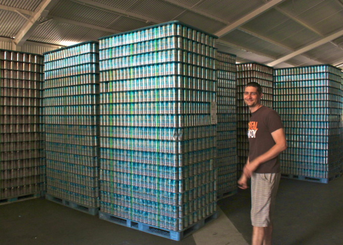 Golden Road Brewing's co-founder Tony Yanow stands in front of stacks of empty cans at the brewery in Atwater Village. Golden Road has four different labels that will soon be available at most major grocery stores in LA.