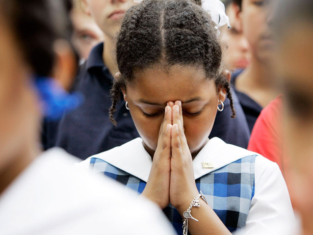 Alexandria McPherson, 8, prays during a National Day of Prayer gathering at City Hall in San Antonio in 2007.