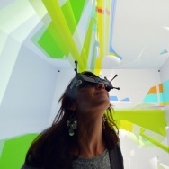 A woman wearing 3D glasses tests a Cave Automatic Virtual Environment (CAVE) virtual reality theatre during its presentation at the Industrial Centre for Virtual Reality in Saint-Nazaire on December 1, 2014. This CAVE is unique of its kind in France with a five-sided HD cellar of 3x3m whose aim is to obtain the perfect image in a realistic and interactive 3D immersion.