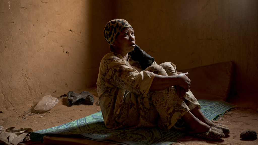 Janet Kamara, who is from Liberia, sits during an interview conducted in an International Organization for Migration transit center in Arlit, Niger, on June 2. Kamara was expelled from Algeria and left stranded in the Sahara while pregnant.