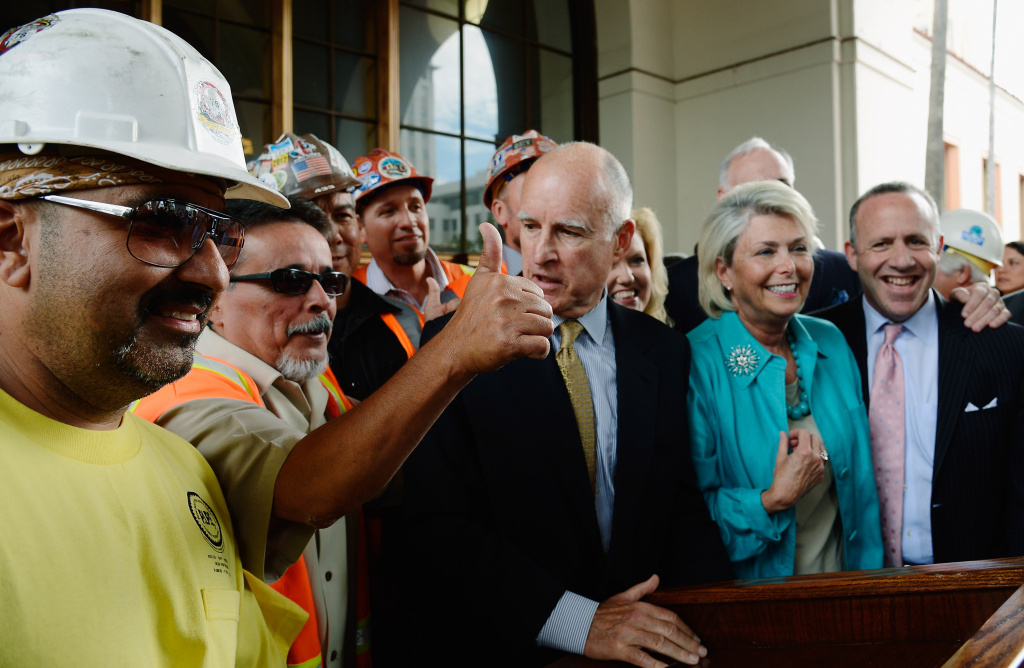 LOS ANGELES, CA - JULY 18:  California Gov. Jerry Brown surrounded by construction workers and elected officials speaks after signing a legislation authorizing initial construction of California's $68 billion high-speed rail line with Los Angeles Mayor Antonio Villaraigosa (L) and state and city officials looking at Union Station on July 18, 2012 in Los Angeles, California. The bill authorizes $10 billion in state bonds to start construction of a high-speed rail line between Los Angeles and San Francisco.  (Photo by Kevork Djansezian/Getty Images)
