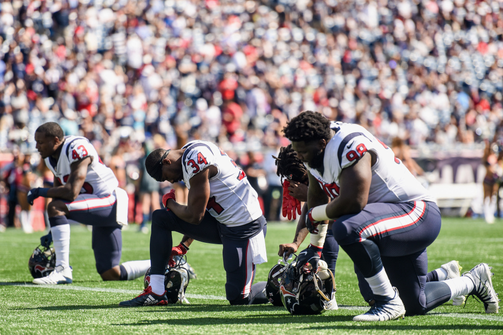 Members of the Houston Texans kneel before a game against the New England Patriots at Gillette Stadium on September 24, 2017 in Foxboro, Massachusetts.