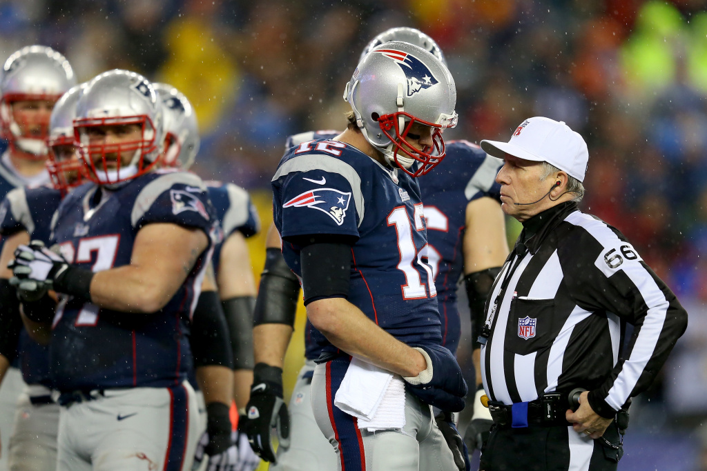 FOXBORO, MA - JANUARY 18:   Tom Brady #12 of the New England Patriots talks with referee Walt Anderson #66 during the 2015 AFC Championship Game against the Indianapolis Colts at Gillette Stadium on January 18, 2015 in Foxboro, Massachusetts.  (Photo by Jim Rogash/Getty Images)