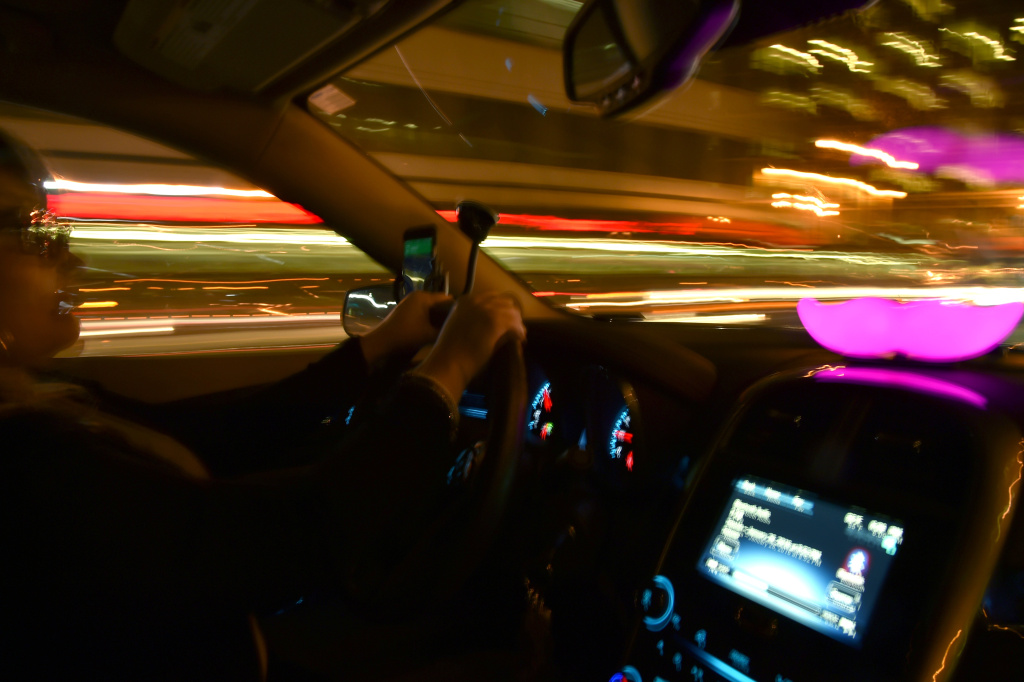 Lyft passengers and drivers ride in a car on February 3, 2016 in San Francisco, California.