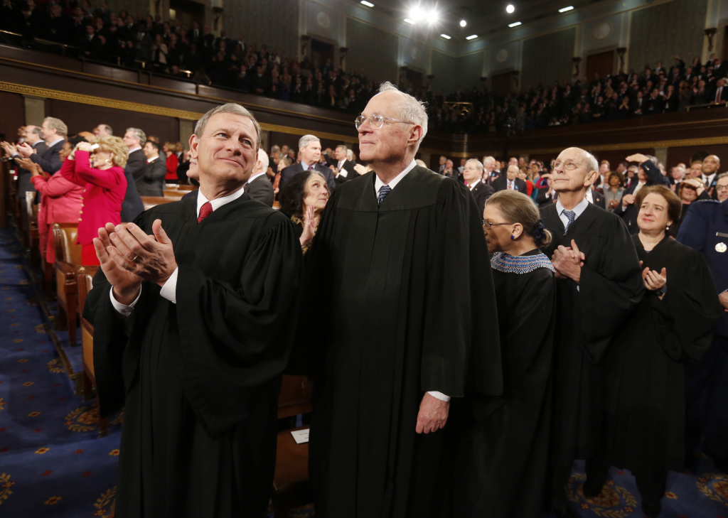 U.S. Supreme Court Chief Justice John Roberts (L) applauds with fellow Justices Anthony Kennedy (2nd from L), Ruth Bader Ginsburg, Stephen Breyer and Elena Kagan (R) prior to President Barack Obama's State of the Union speech on Capitol Hill on January 28, 2014 in Washington, DC.