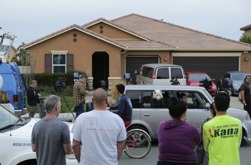 A home where a couple was arrested after police discovered that 13 people had been held captive in filthy conditions with some shackled to beds with chains and padlocks, on Monday in Perris, Calif.