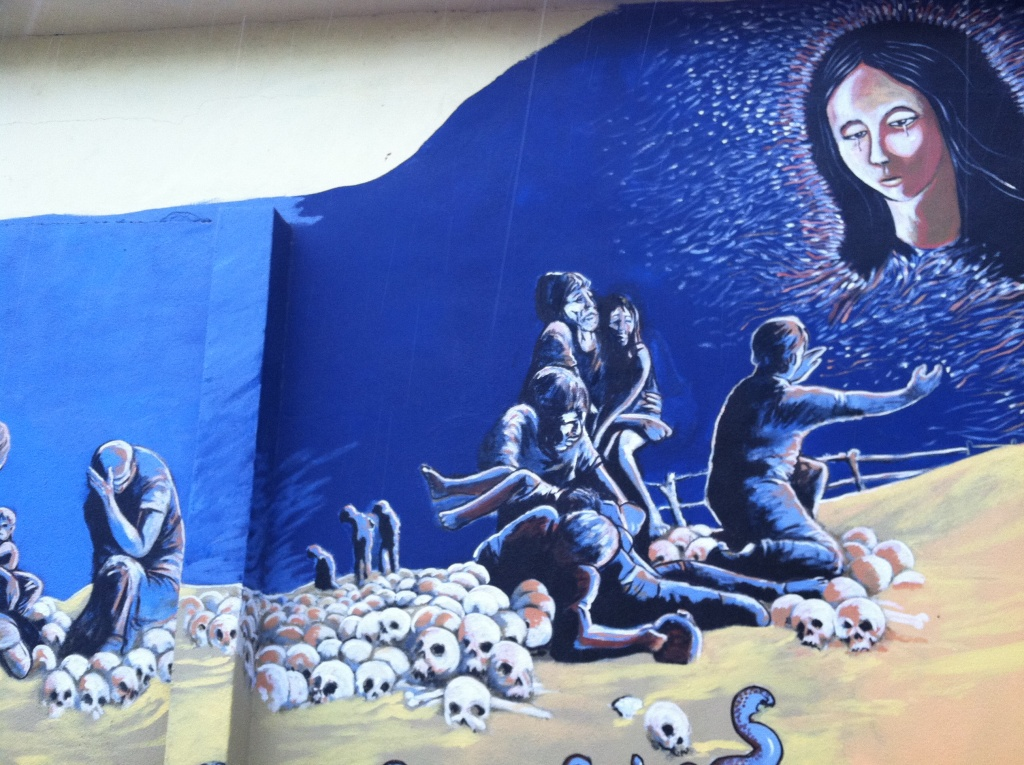 A mural that pays tribute to the migrants who make the perilous journey across the desert decorates a wall in the center of Altar.