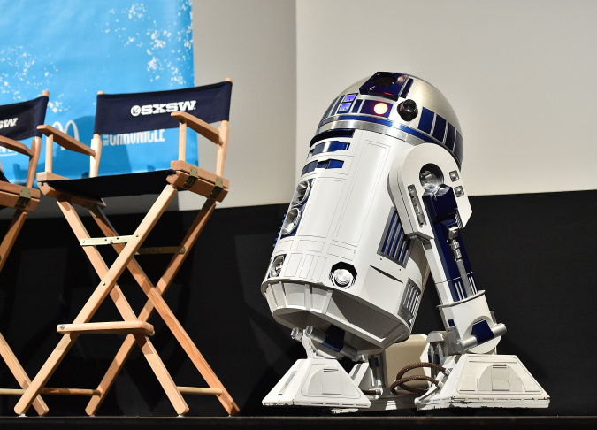 LOS ANGELES, CA - DECEMBER 17:  Star Wars character R2-D2 droid brings the wedding rings during the Star Wars-themed wedding of Andrew Porters and Caroline Ritter of Australia in the forecourt of TCL Chinese Theatre IMAX on December 17, 2015 in Hollywood, California. (Photo by Kevork Djansezian/Getty Images)