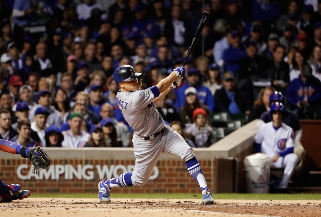 Enrique Hernandez #14 of the Los Angeles Dodgers hits a grand slam in the third inning against the Chicago Cubs during game five of the National League Championship Series at Wrigley Field on October 19, 2017 in Chicago, Illinois.