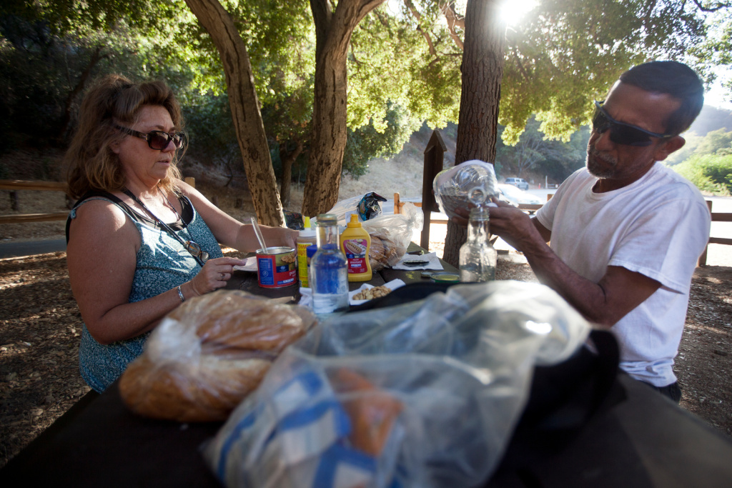Terri Hammer, left, and husband Mario Barreda of Pasadena enjoy a picnic at Angeles National Forest on Tuesday, Oct. 1. Nine national parks in California affected by the government shutdown starting Tuesday, Oct. 1. Hammer and Barreda are camping at the Millard Campground, and haven't been asked to leave because of the shutdown. They hope that will remain the case.
