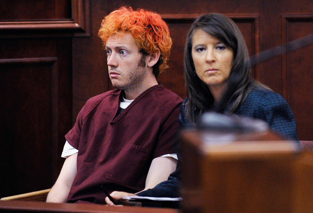 Accused movie theater shooter James Holmes (L) makes his first court appearance at the Arapahoe County Courthouse with his public defender Tamara Brady on July 23, 2012 in Centennial, Colorado. According to police, Holmes killed 12 people and injured 58 others during a shooting rampage at an opening night screening of