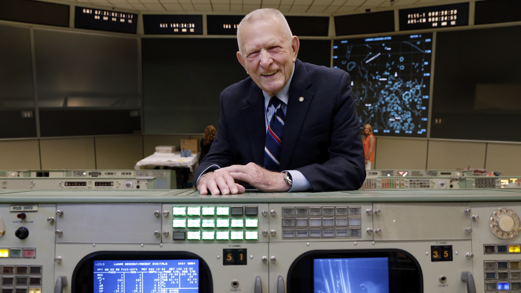 Gene Kranz stands behind the console at Mission Control in Houston where he worked during the Gemini and Apollo missions.