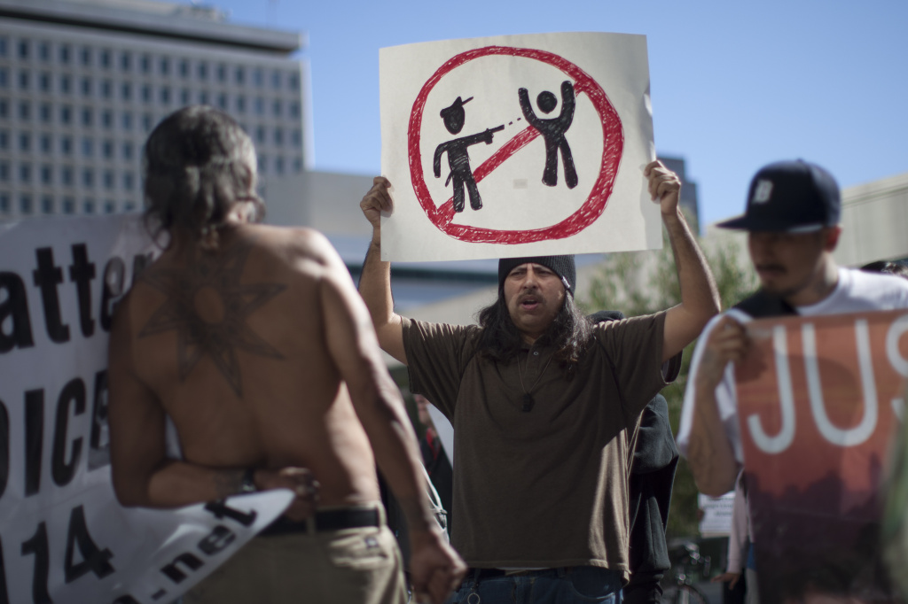 Protesters at Los Angeles Police Department Headquarters rally to express their anger over the fatal police shooting of an unarmed homeless man on March 3, 2015 in Los Angeles, California.