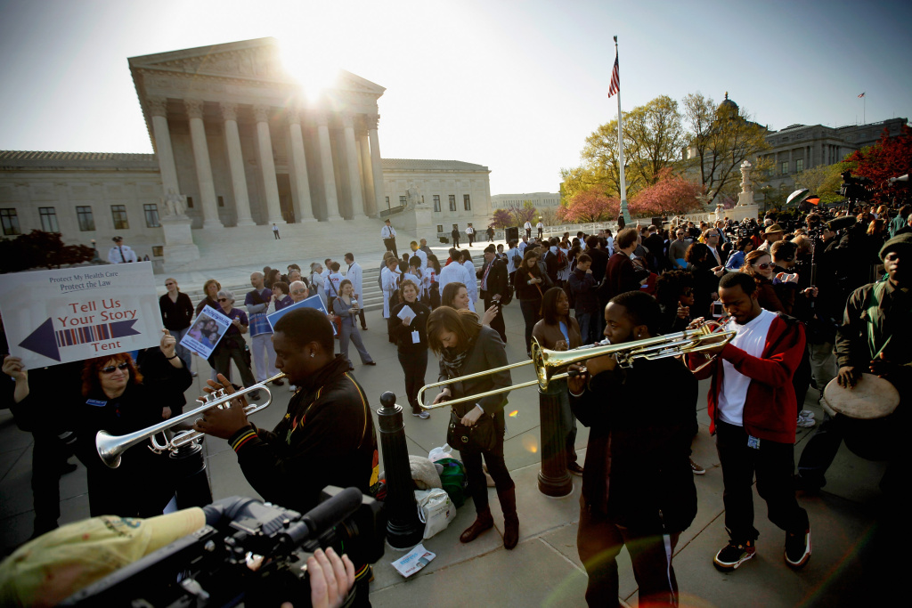 Demonstrators for and against the Patient Protection and Affordable Care Act march and chant in outside the U.S. Supreme Court Building on March 26, 2012, in Washington, DC. Today the high court, which has set aside six hours over three days, will hear arguments over the constitutionality of the act.