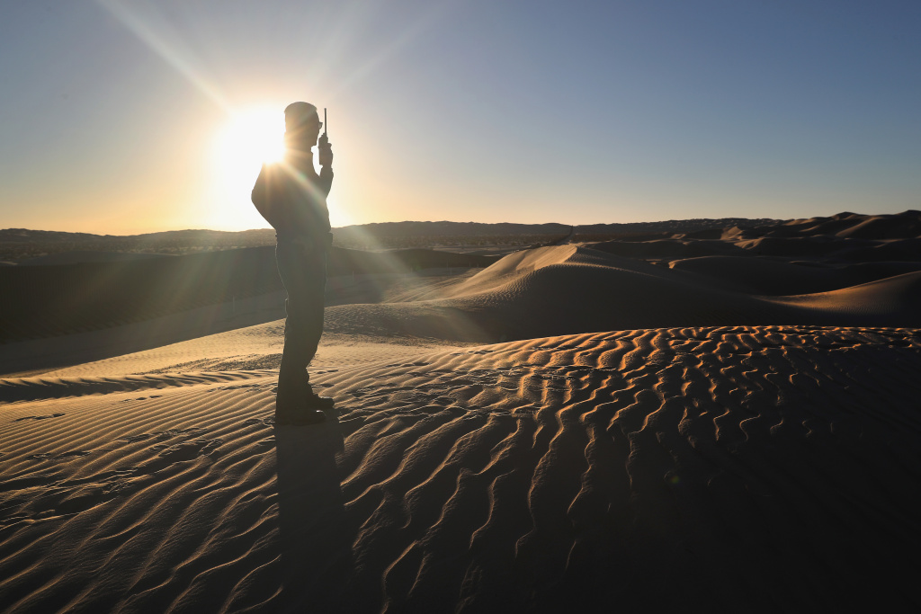 A U.S. Border Patrol agent monitors the U.S.-Mexico border at the Imperial Sand Dunes on November 17, 2016 near Felicity, California. The 15-foot border fence there, also known as the