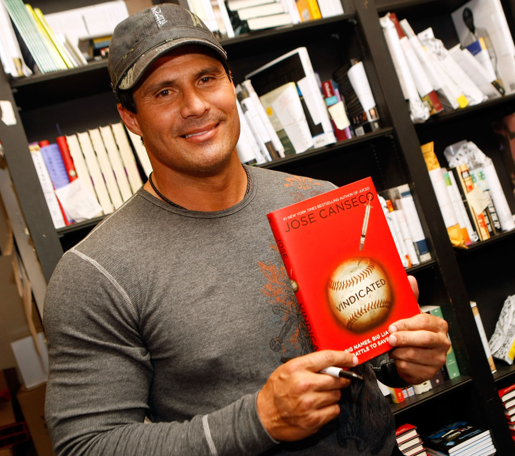 "Former baseball player and author Jose signs copies of his new book ""Vindicated: Big Names, Big Liars, and the Battle to Save Baseball"" at Book Soup on April 7, 2008 in Los Angeles, California."