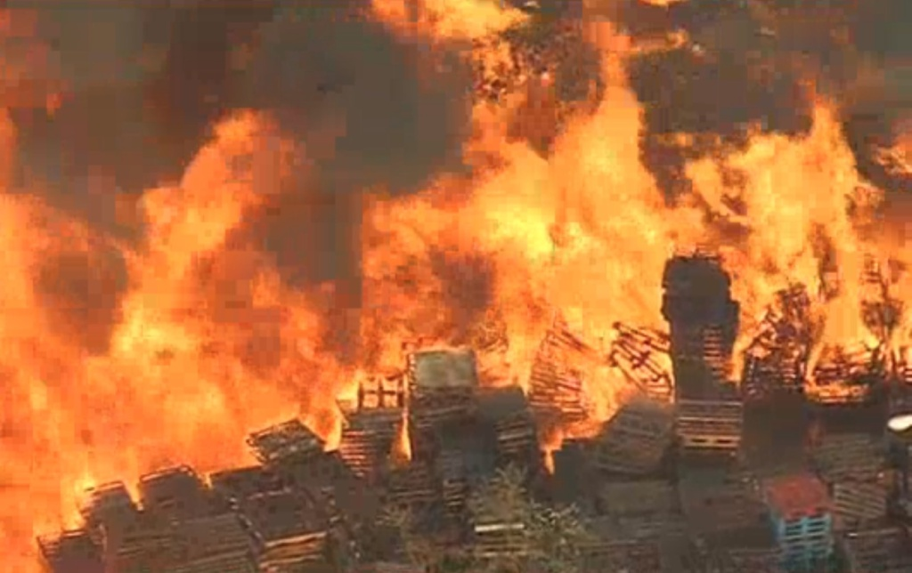 Massive fire at California recycling plant puts city under smoke alert