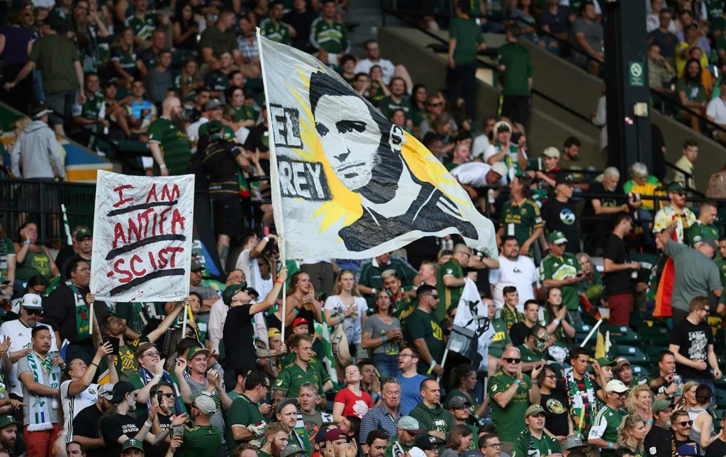Portland Timbers fans wave flags before the team's match against the Seattle Sounders on Friday, August 23, in Portland, Oregon.
