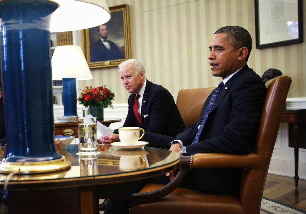 U.S. President Barack Obama (R) and U.S. Vice President Joseph Biden sit during a meeting with Secretary of Treasury Jacob Lew in the Oval Office of the White House December 16, 2013 in Washington, DC.