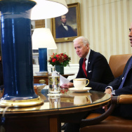 U.S. President Barack Obama (R) and U.S. Vice President Joseph Biden sit during a meeting with Secretary of Treasury Jacob Lew, Secretary of Labor Thomas Perez, National Security Adviser Susan Rice, Director of the National Economic Council Gene Sperling, Secretary of Commerce Penny Pritzker, and Trade Representative Michael Froman in the Oval Office of the White House December 16, 2013 in Washington, DC.