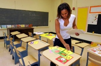A teacher prepares her classroom. A new survey found that more than half of teachers surveyed reported three days or less of Common Core standard training.