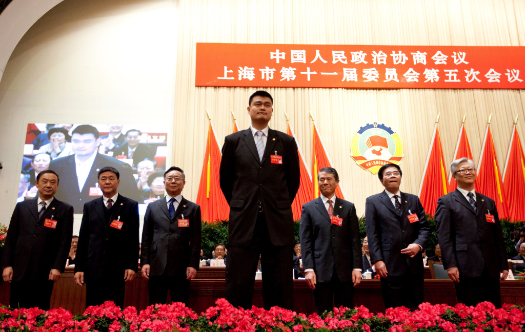 China's former NBA superstar Yao Ming (C) attends as newly elected member of Chinese People's Political Consultative Conference (CPPCC) of Shanghai, and takes part in a meeting for the CPPCC in Shanghai on Jan. 15, 2011. Ming has been busy since he left professional basketball in July – he's gone back to school, launched a wine label, and been elected onto this committee.