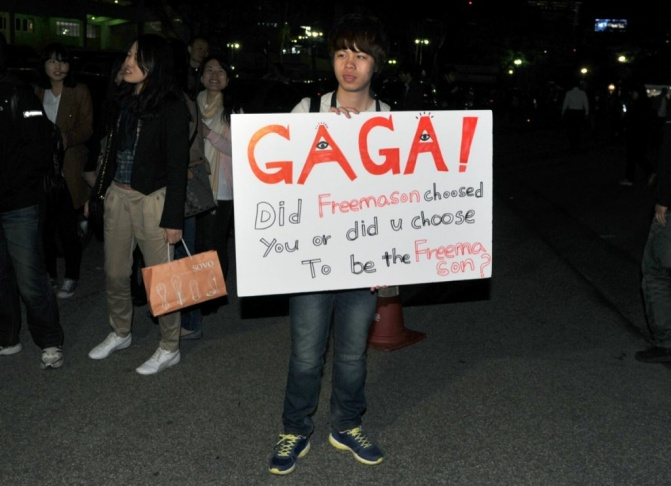 A South Korean man holds a placard again