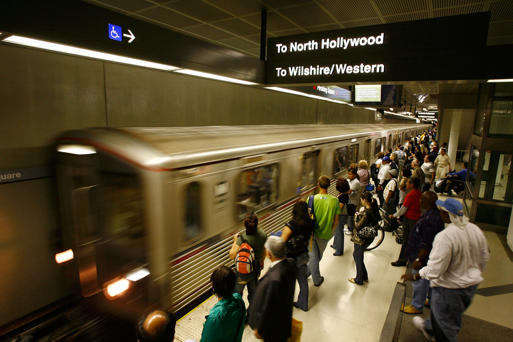 Passengers board Metrolink subway trains during rush hour in Los Angeles, California.