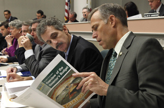 Assembly members Mike Feuer, D-Monterey Park, left and Jared Huffman, D-San Rafael, look over a copy of the Legislative Analyst's report on Gov. Jerry Brown's proposed 2011-12 budget, during a hearing of the Assembly budget committee at the Capitol in Sacramento, Calif., Thursday, Jan. 13, 2011. Lawmakers began going through Brown's proposed $84.6 billion general fund spending plan that contains taxes, cuts and major government restructoring to try to fill an estimated $25.4 billion budget gap.