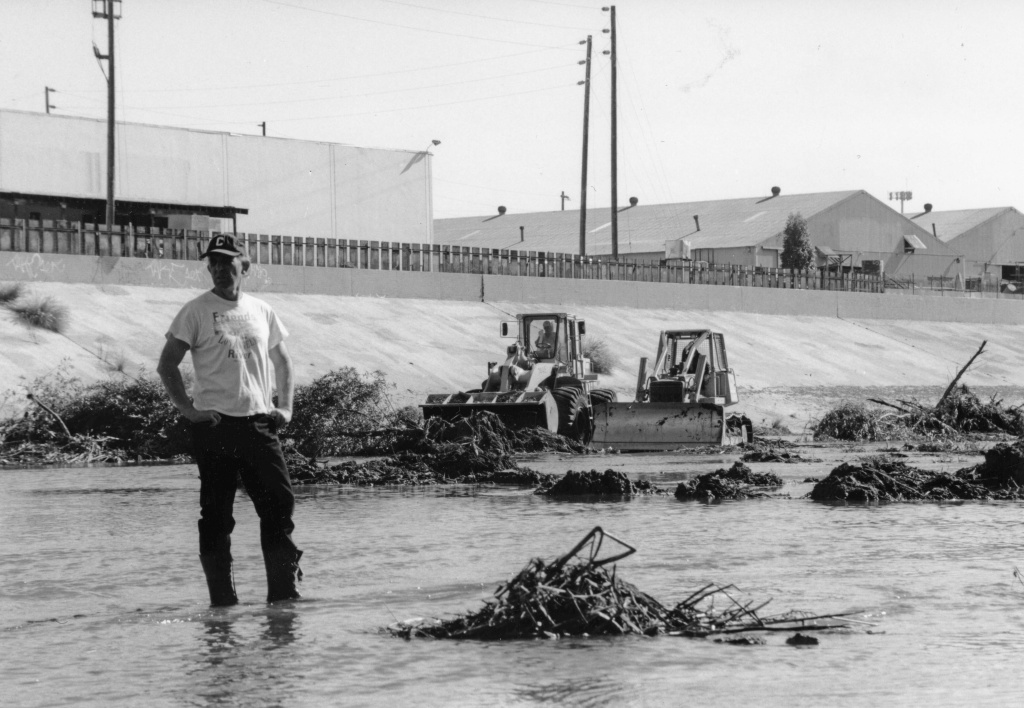 Lewis MacAdams protests the destruction of vegetation in the Los Angeles River in 1995 by standing in front of the bulldozers and refusing to move.