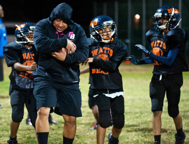 The Watts Bears are a football team of nine through eleven year olds in the Pop Warner Pee Wee league. Four LA police officers coach the team, which heads to a bowl game in Murrieta, Calif. on Saturday.