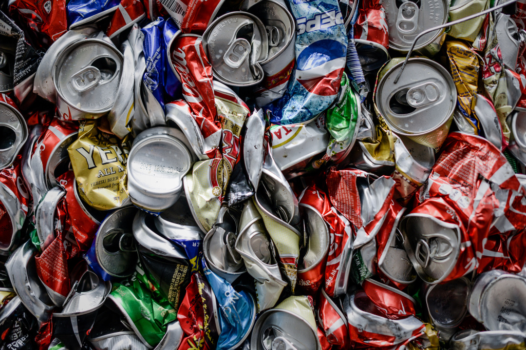 Aluminum cans are seen compressed before recycling.