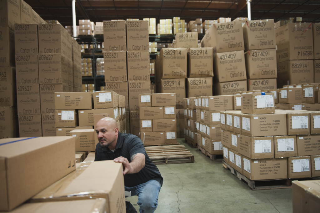 Guillermo Verdugo, a warehouse manager at one of the two facilities owned by Pacific Mountain Logistics in Mira Loma, California, checks stock at the end of the day.