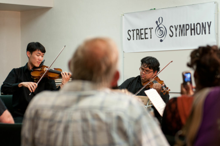 Downtown Skid Row Mental Health Center client, Diana Dow, talks one on one with Robert Gupta about his performance and her enjoyment of classical music.
